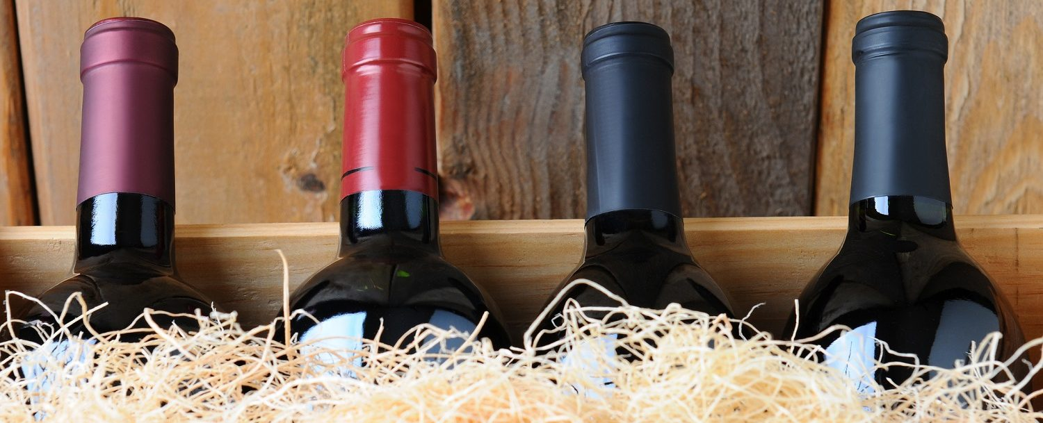 wine bottles in a wooden box with straw