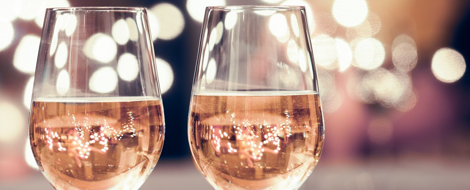 two glasses of rose wine with blurred background